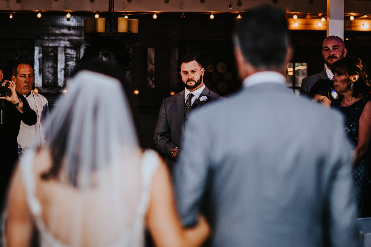 a groom sees his bride for the first time