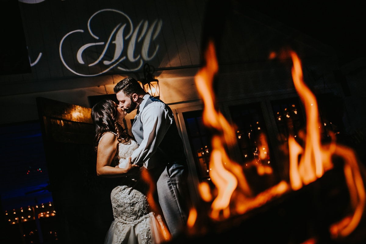 bride and groom night shot with fire
