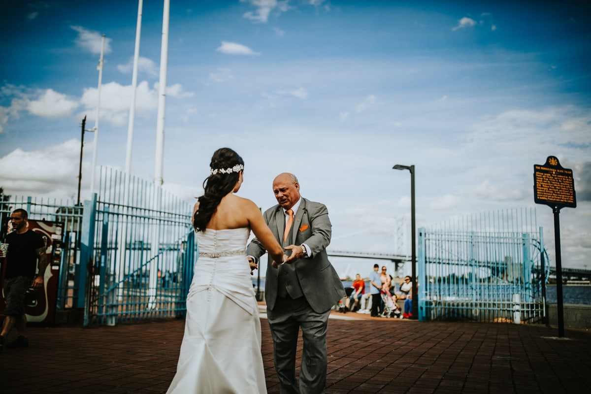 Father looks at bride