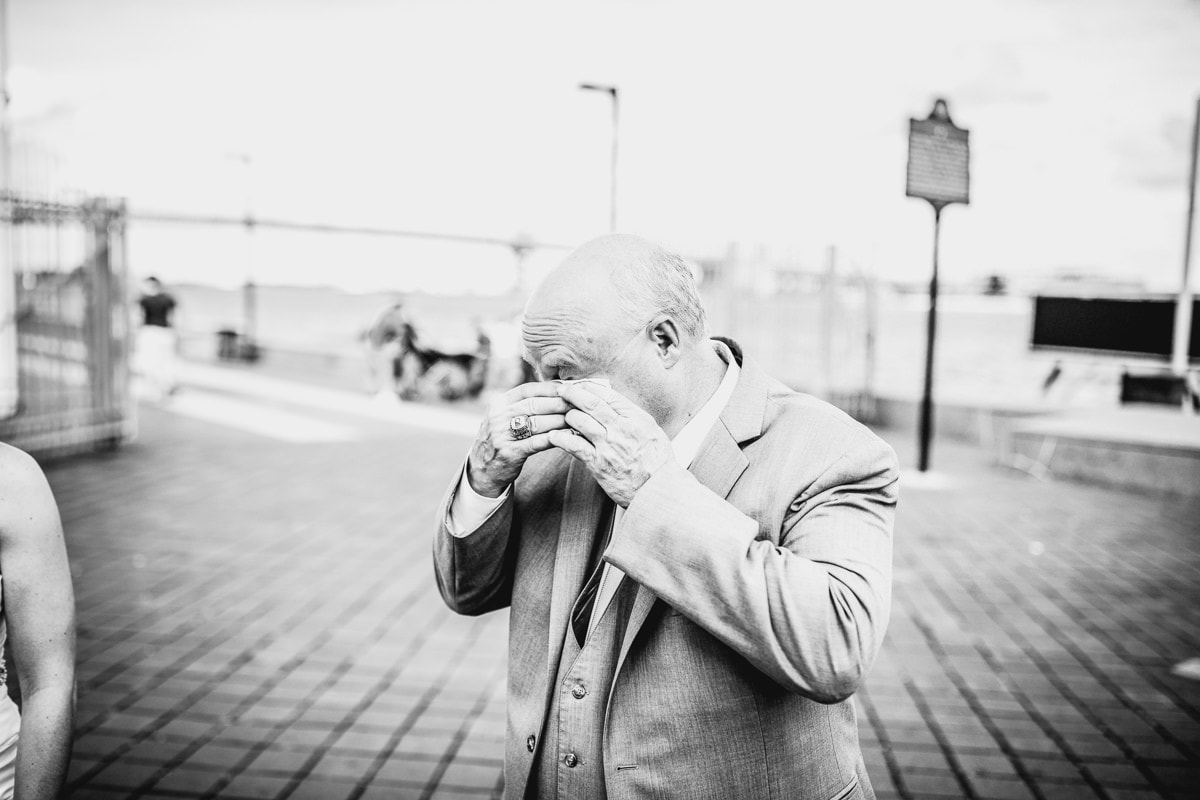 dad tears up as he looks at bride