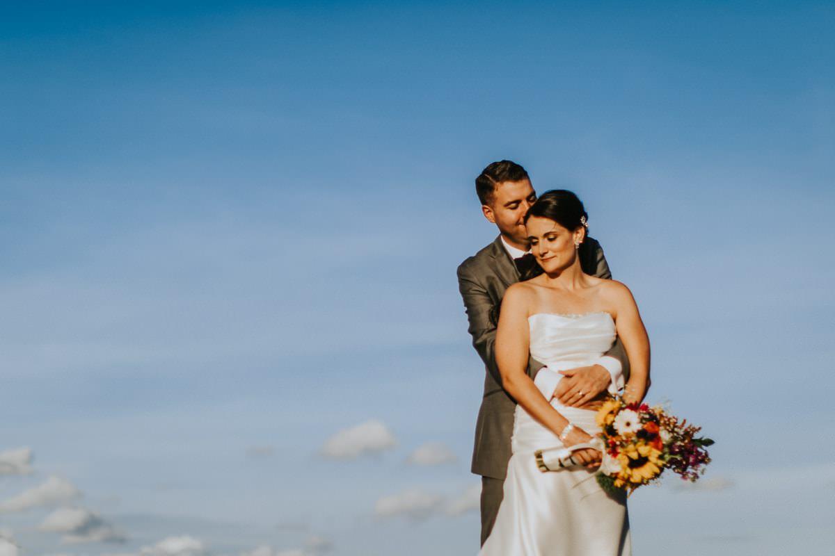 bride and groom and big skies