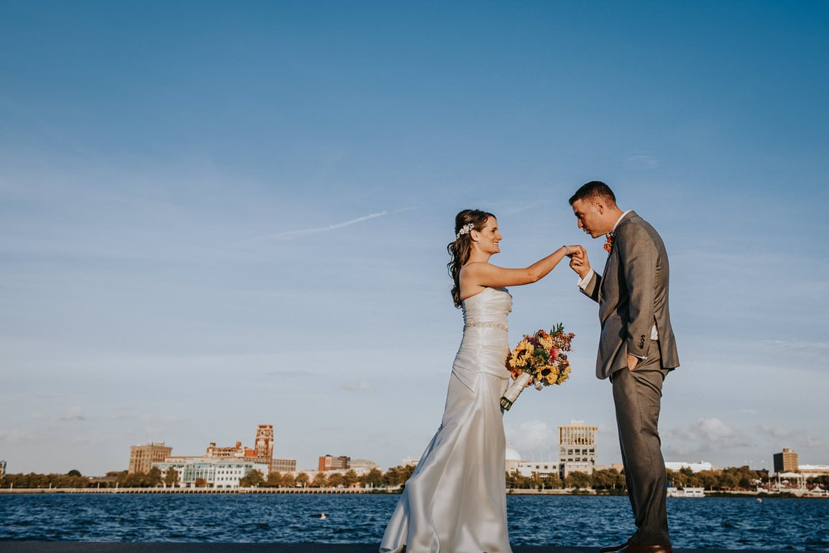 groom kisses brides hand