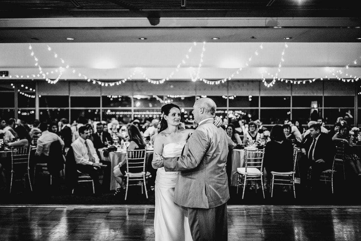 father dances with daughter at wedding
