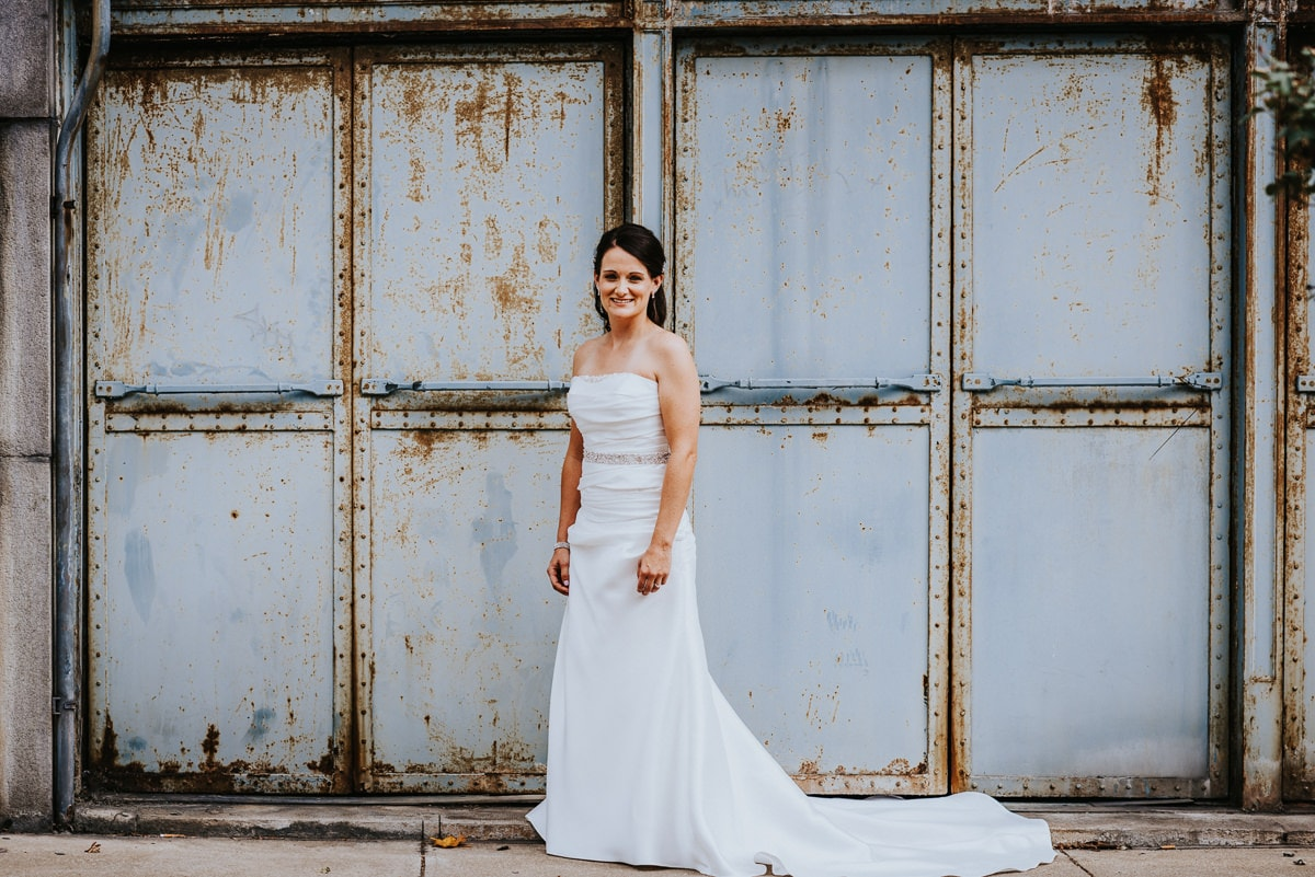 bride in front of wall