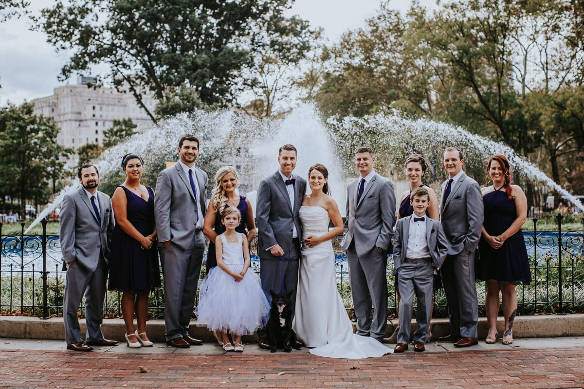 bridal party in front of Franklin square fountain