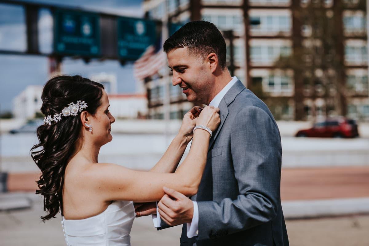 bride fixes grooms tie