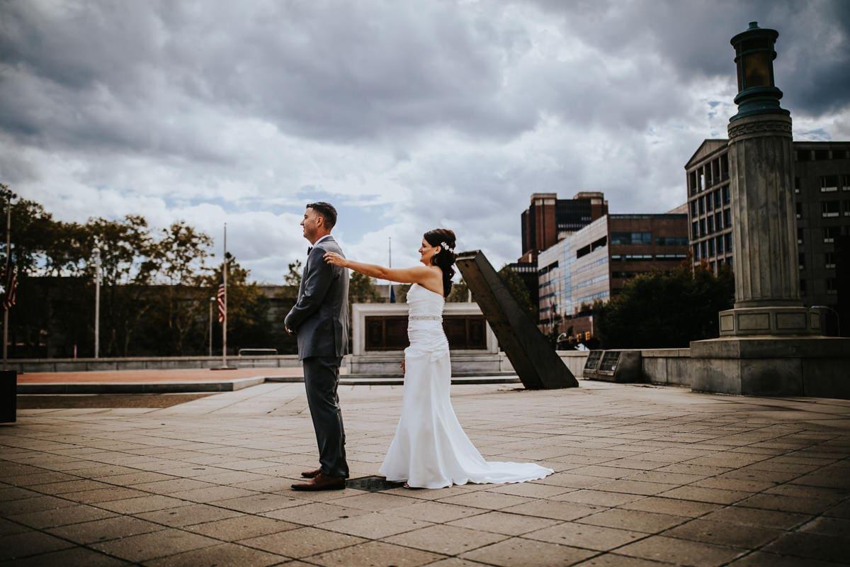 bride taps groom on shoulder