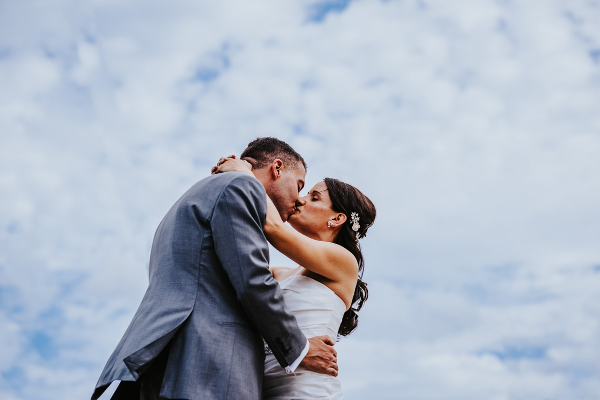 bride and groom with dramatic skies